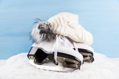 Ice skates with cap Royalty Free Stock Images