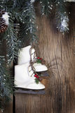 Ice Skates with Evergreen Boughs Stock Images