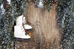 Ice Skates with Evergreen and Snow Royalty Free Stock Photos