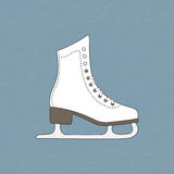 Ice skates. Figure skate over ice rink background with many blade trails Stock Photography