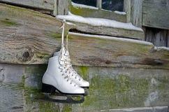 Ice skates hanging on barn Stock Photos