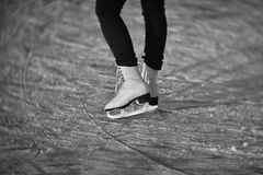 Ice skates. Ladies ice skates - the lady is skating on the frozen pond. Photo with the Petzval construction lens Royalty Free Stock Photo