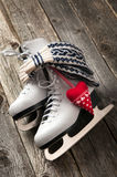 Ice skates on old wooden boards. The white ice skates on old wooden boards royalty free stock photo