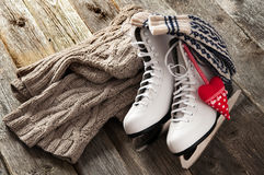 Ice skates on old wooden boards. The white ice skates on old wooden boards royalty free stock images