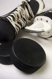 Ice skates with pucks Royalty Free Stock Photo