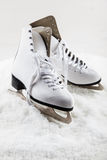 Ice skates on snow Royalty Free Stock Images