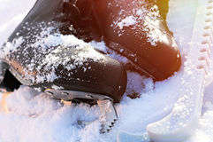 Ice skates in the snow Stock Images