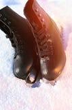 Ice skates in the snow Stock Photo
