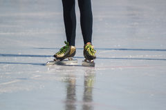 Ice skates, winter sport - green colourful boots Stock Images