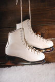 Ice skates on wooden background Stock Photos