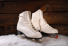 Ice skates on wooden background Royalty Free Stock Photo
