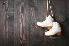Ice skates on a wooden background stock photo