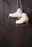 Ice skates on a wooden background Stock Photography