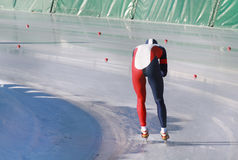 Ice skating. A speedskater races on the ice royalty free stock image