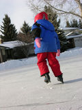 Ice skating. Ice-skating child on the ice Stock Image