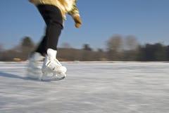 Ice skating. Ice-skating on a frozen lake royalty free stock photo