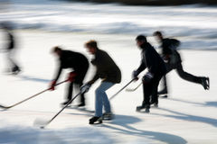 Ice skating. In denmark the winter with people ice skating and playing hockey, low shutter speed and panning royalty free stock photos