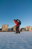 Ice skating. Nordic ice skating on the sea in front of city buildings stock photo