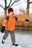 Ice skating. Boy ice skating for the first time Stock Photography