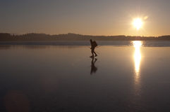Ice skating. A man ice skating alone on a partly frozen sea Royalty Free Stock Photo