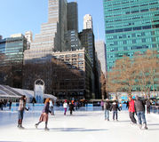 Ice Skating At Bryant Park. Skaters enjoying a beautiful day  at Bryant Park's ice rink in Manhattan,NY Royalty Free Stock Photos