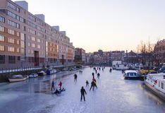Ice skating on the canals in Amsterdam Royalty Free Stock Photo