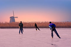 Ice skating in the countryside from Netherlands at sunset Royalty Free Stock Photography