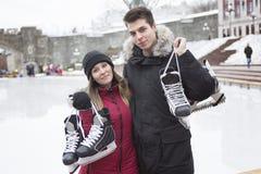 Ice skating couple having winter fun on ice skates Royalty Free Stock Images