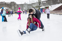 Ice skating couple having winter fun on ice skates Stock Photography