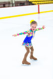 Ice skating. Cute girl practicing ice skating before her first competition Stock Images