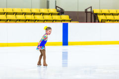 Ice skating. Cute girl practicing ice skating before her first competition Royalty Free Stock Image