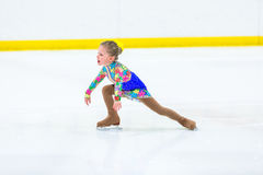 Ice skating. Cute girl practicing ice skating before her first competition Royalty Free Stock Photography