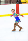 Ice skating. Cute girl practicing ice skating before her first competition Stock Image