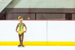 Ice skating. Cute girl practicing ice skating before her first competition Royalty Free Stock Photos