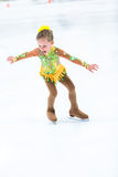 Ice skating. Cute girl practicing ice skating before her first competition Stock Photography