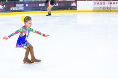 Ice skating. Denver, Colorado, USA-March 16, 2015. Cute girl practicing ice skating before her first competition Stock Photos