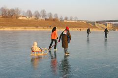 Ice-skating family. A family skating on the frozen river danube in vienna Stock Photo