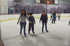 Ice skating. With family and friends skating on Kendall stock photo