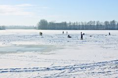 Ice-skating on frozen lake Stock Image