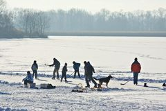 Ice-skating on frozen lake Stock Images