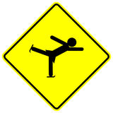 Ice skating girl vector yellow sign. Vector yellow sign with a black ice skating girl symbol Royalty Free Stock Image