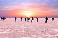 Ice skating on the Gouwzee at sunset in the Netherlands Stock Photos