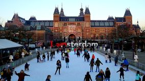 Ice skating at the ice rink at the RIjksmuseum in Amsterdam Netherlands stock video footage