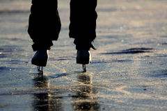 Ice Skating III. People ice skating on a frozen lake royalty free stock image