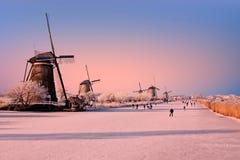 Ice skating at Kinderdijk in Netherlands at sunset Royalty Free Stock Photos