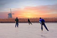 Ice skating at Kinderdijk in Netherlands at sunset Royalty Free Stock Image