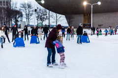 Ice Skating Lessons. Mother teaching her daughter how to ice skate at the Empire State Plaza in Albany NY Stock Images