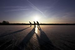Ice skating in the Netherlands. Ice skating at sunset in the countryside in the Netherlands Royalty Free Stock Photography