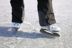 Ice skating outdoors pond freezing winter Royalty Free Stock Image