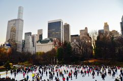 Ice-skating people with white Christmas in Central Park, New York City, USA. Stock Photography